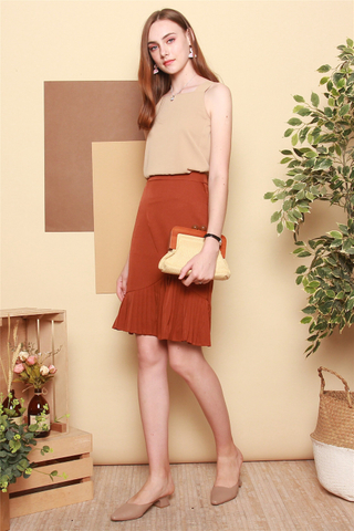 Pleated Asymmetrical Midi Skirt in Rust