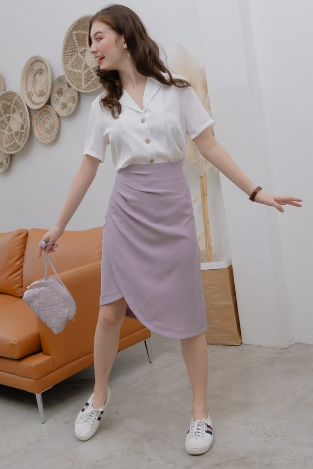 *BACK IN STOCK* Ruched Asymmetrical Midi Skirt in Lilac